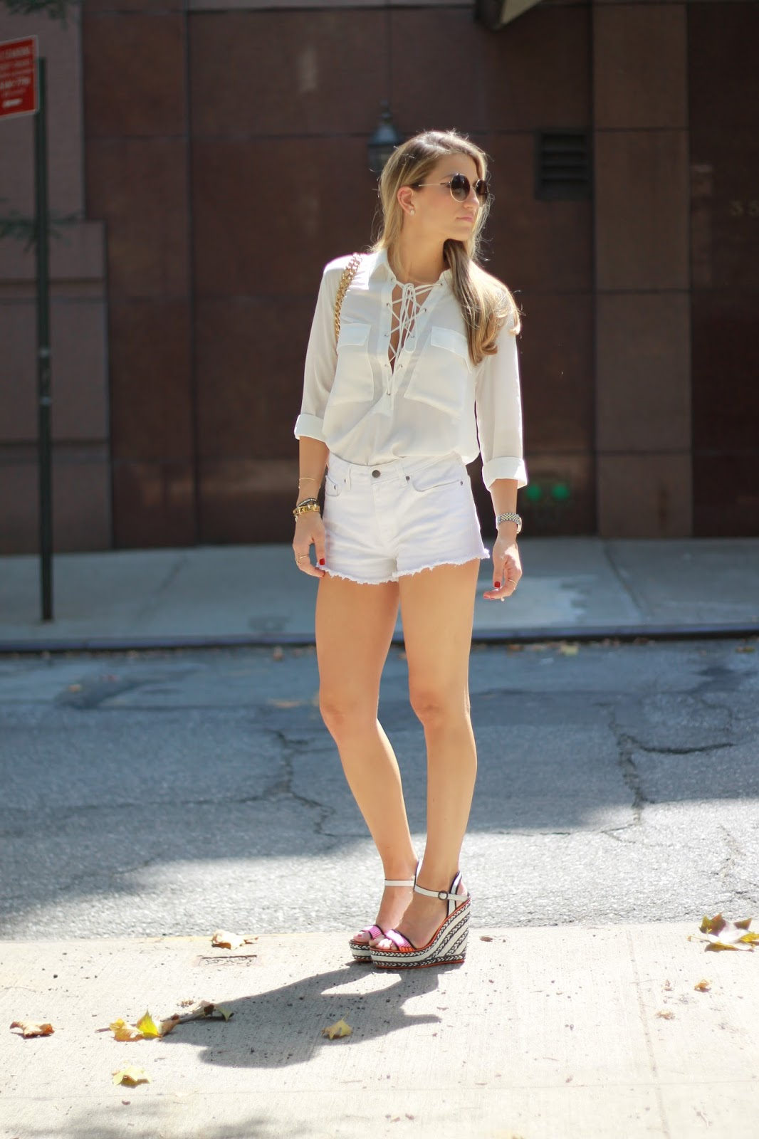 white denim cutoffs, white long sleeve lace up blouse