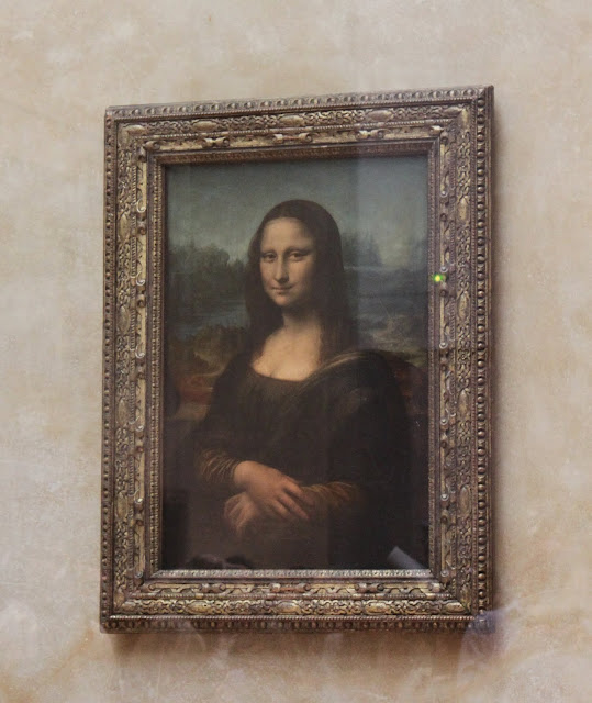 The famous Mona Lisa in Lourve Museum in Paris, France