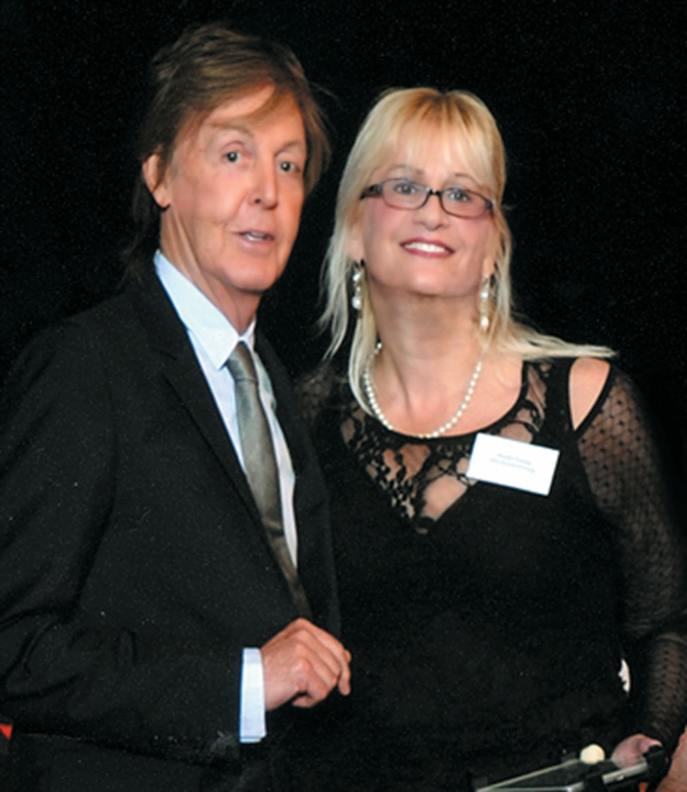 Sir Paul McCartney Congratulates Suzahn Fiering Onstage During The LIPA Ceremony