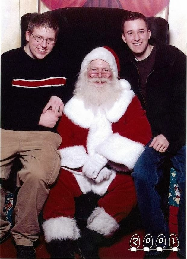 Two Brothers Smile With Santa for 34 Years