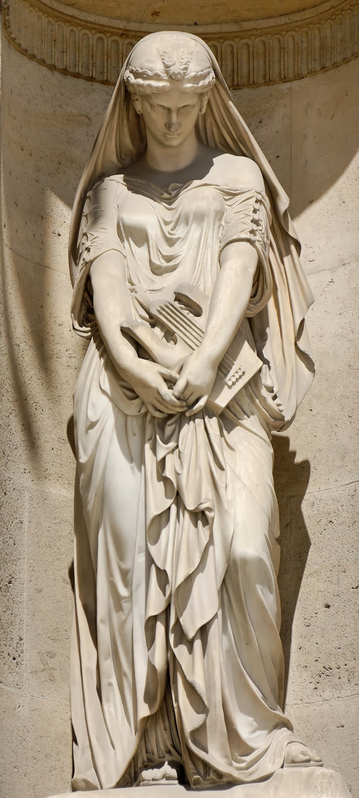 http://commons.wikimedia.org/wiki/File:Sappho_Loison_cour_Carree_Louvre.jpg