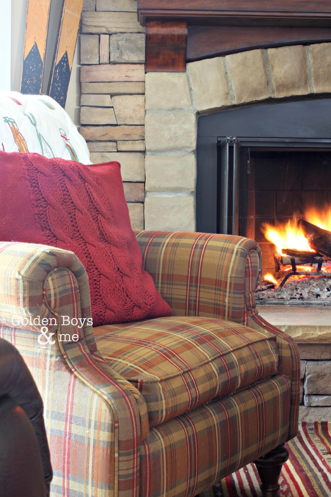 Plaid chair by stone fireplace-www.goldenboysandme.com
