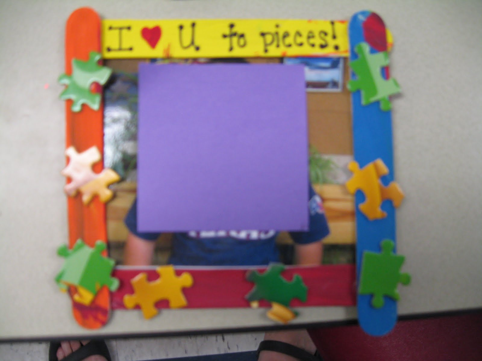 Mothers day gifts first grade shenanigans below is a frame made out of popsicle sticks that the students painted i hot glued puzzle pieces to the sticks and added the sentence i love you to jeuxipadfo Images