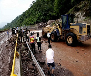 Rescuers clearing the landslide section in Shuifu County, southwest China's Yunnan Province