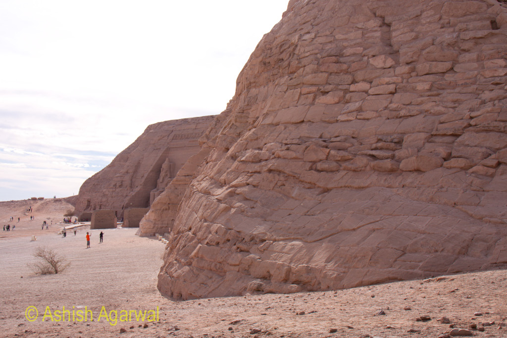 The base of the large hill and a glimpse of the statues at the temple of Abu Simbel