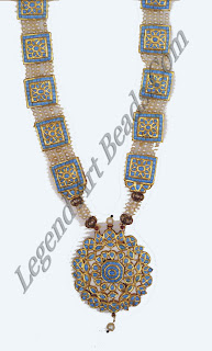 A pearl and turquoise pairihar or paneled necklace with enamel reverses. It was bought in India in 1881 by Marian Itivette-Laneve, who admired it for its traditional workmanship and the purity of its design.