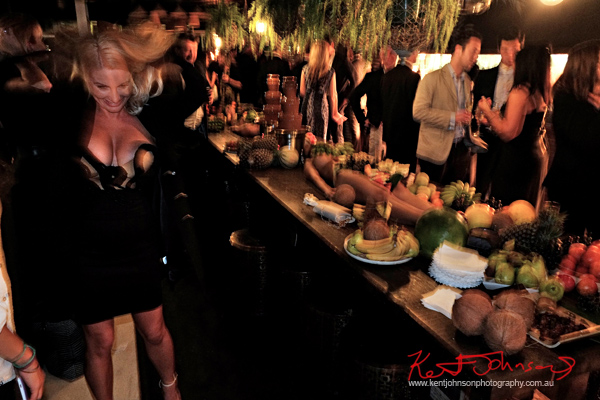 Zilda Williams poses with 'nude as fruit platters' in the background at Cruise Bar re-launch. Photography by Kent Johnson - Street Fashion Sydney.