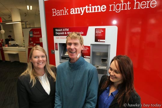 L-R: Louisa Blackman, assistant manager, Westpac Bank, Dickens St, Napier; James Gudsell, Hohepa Hawke's Bay, Taradale; Toni Mackie, his support worker - James revisited the bank to receive a thank you for turning in $2,000 he mistakenly got from the bank's ATM machine. photograph