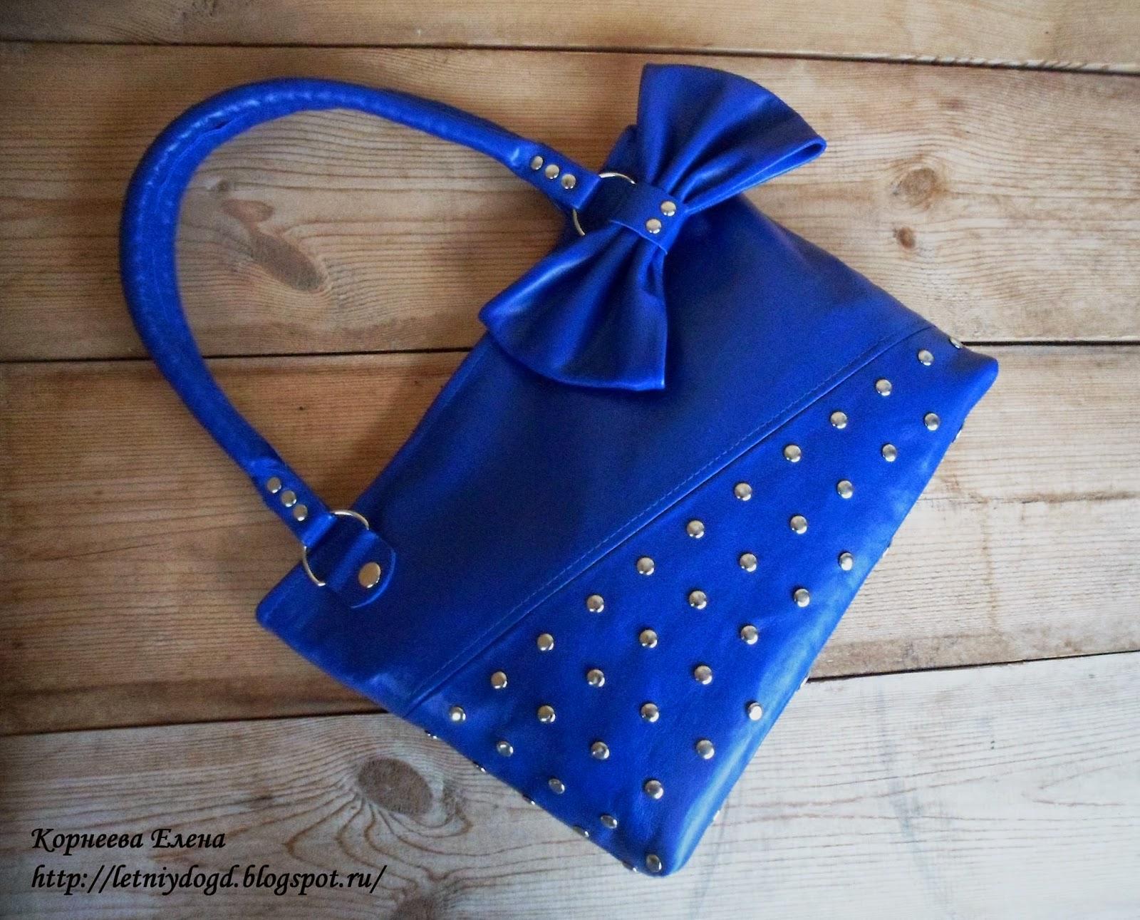 сумка женская из натуральной кожи синего цвета с бантом