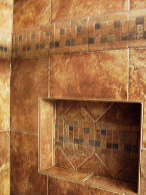 Tile niche uses triangles and matching accent band