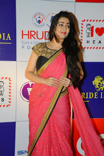 Actress Charmy Kaur Latest Pictures in Pink Saree at CCL Charity Dinner  31