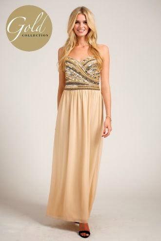 http://www.little-mistress.co.uk/dresses-c101/maxi-dresses-c105/cream-heavily-embellished-diagonal-detail-bandeau-maxi-dress-p1046