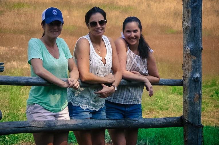 Three girls on fence- Beyond the Blue Umbrella
