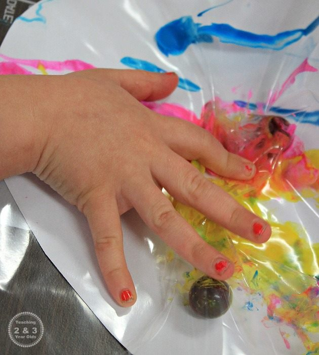 painting in a freezer bag with marbles