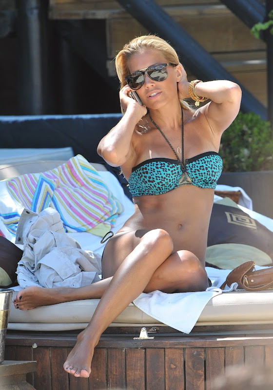 Sylvie van der Vaart talking on the phone in a blue bikini