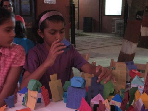 child arranging Origami models