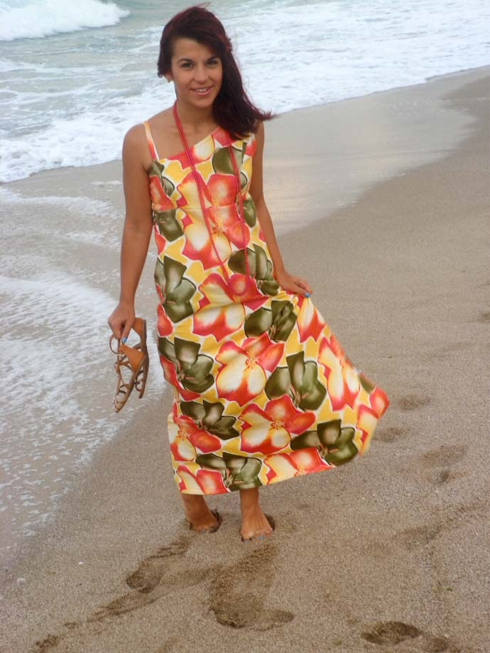 Outfit I am wearing: A floral Greek style maxi dress handmade by me, white leather purse, pink long beaded necklaces from H&M and flat sandals from H&M; location: The beach