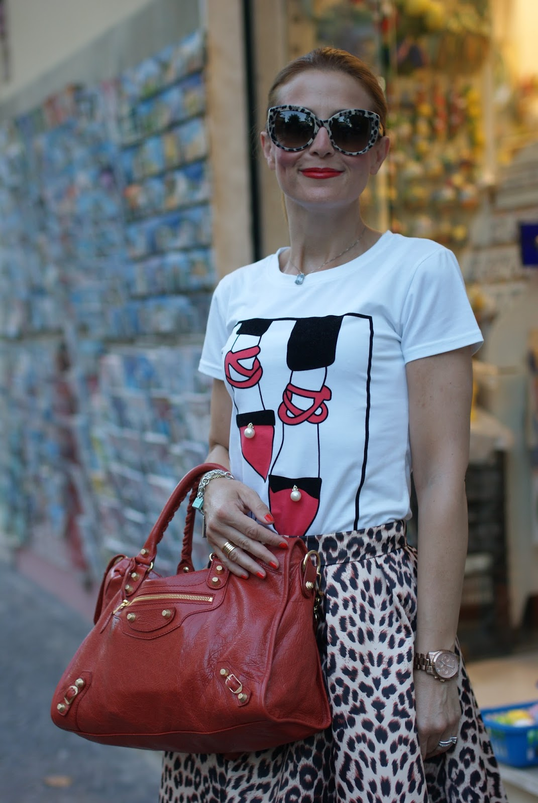 Leopard print is the new neutral with Dolce & Gabbana leopard sunglasses found on Giarre.com, leopard print midi skirt and coral Balenciaga city on Fashion and Cookies fashion blog, fashion blogger style