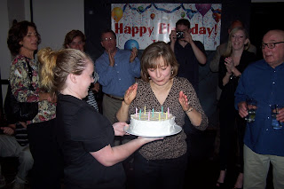 E blows out the candles