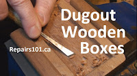 using a chisel to dig out a wooden box