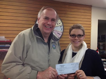 Yours Truly Presents $2000 Check to Chamber's Kylie Peck for Use in Snowtown USA