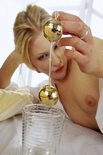 Horny Alice stuffs her pussy with big golden Ben Wa balls - Magic Erotica