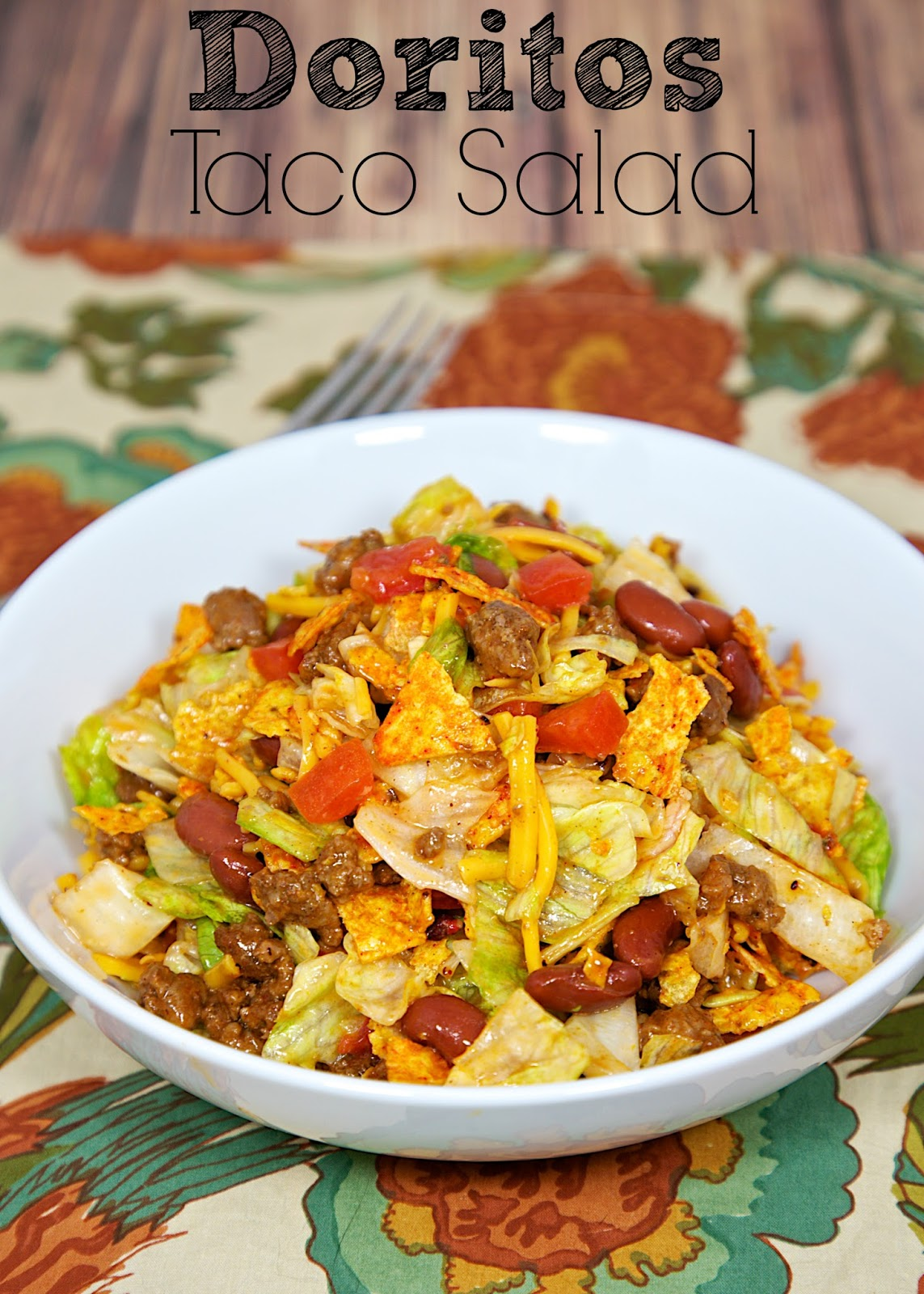 Doritos Taco Salad - taco meat, kidney beans, tomatoes, lettuce, Catalina dressing, cheese and Doritos. Quick Mexican recipe. Kid-friendly - who wouldn't want to eat Doritos for dinner?!