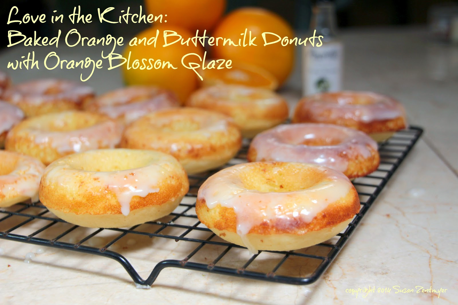 baked orange and buttermilk donuts with orange blossom glaze