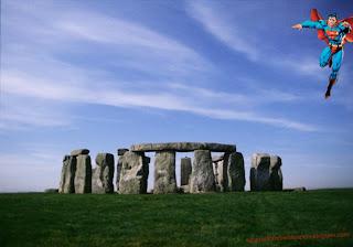 Wallpaper of Superman flying over The Sonehenge Stone Monument background image
