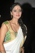 Actress Nivitha Glamorous photos in Saree-thumbnail-16