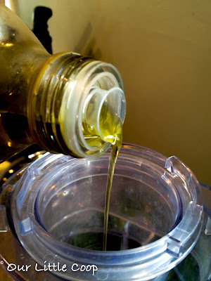basil and olive oil in food processor