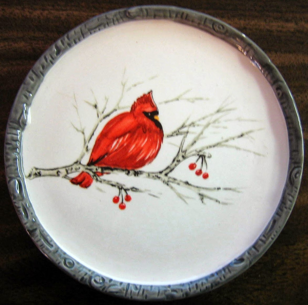 http://www.decorativedishes.net/faux-birch-edge-cardinal-bird-on-branch-decorative-small-plate/