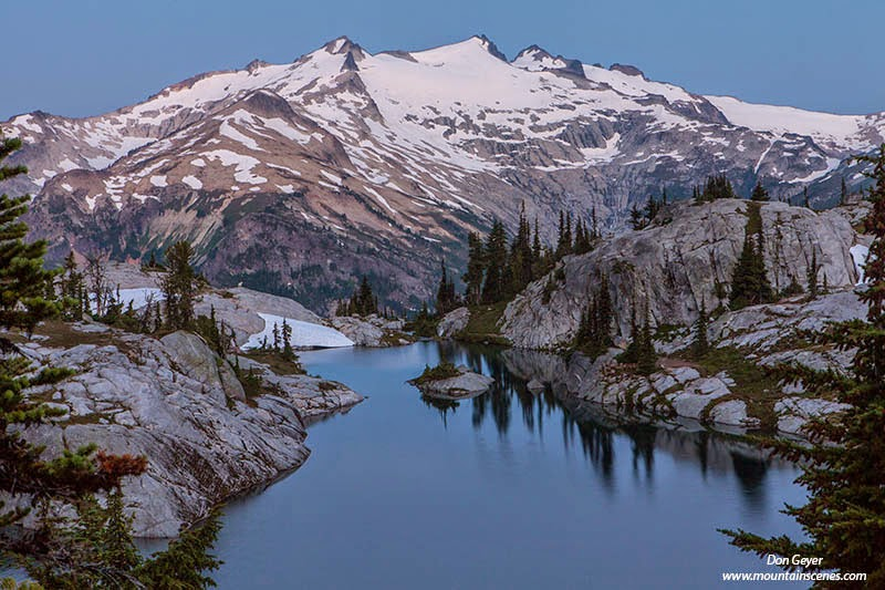 Mount Daniel at twilight above Lower Robin Lake in the Alpine Lakes Wilderness, Cascade Range, Washington, USA.