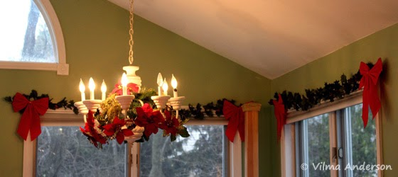 Windows decorated with Christmas garlands and red bows