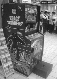 Taito Space Invaders with box to make the game playable by shorter people.