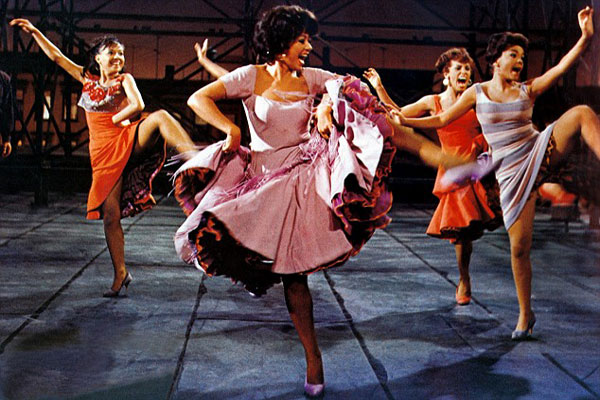 Rita Moreno leads the dancers in West Side Story