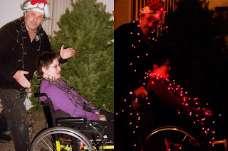pushing wheelchair with Christmas Tree lights