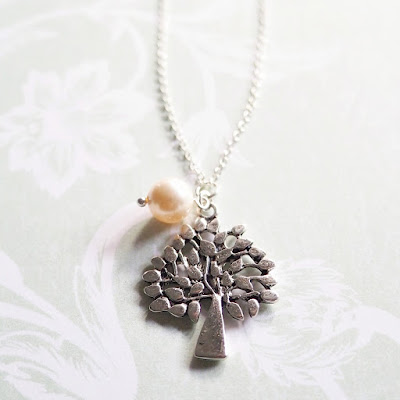 http://www.thecollectiveeffort.com.sg/collections/50-experiences-for-500-kids/products/tree-of-life-pendant-necklace