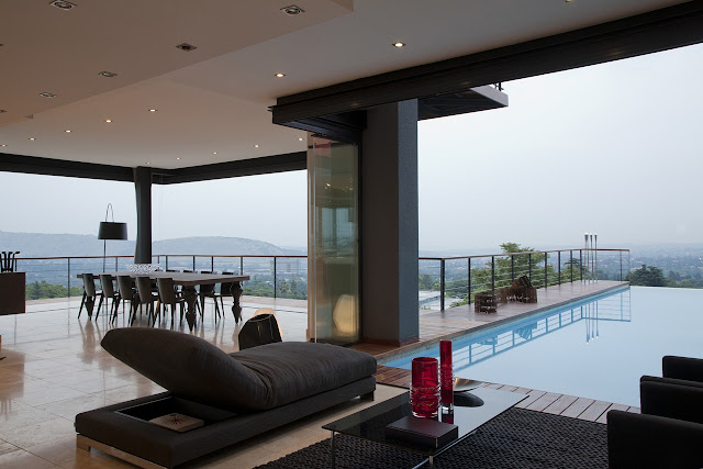 Picture of the black furniture in the living room by the swimming pool