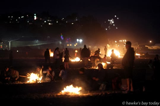 Fires, fireworks, sky rockets, Guy Fawkes night on the beach, Marine Parade, Napier photograph