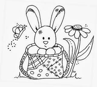 desenho de coelhinho dentro de uma cesta para pintar