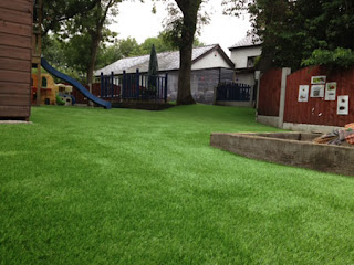 Artificial grass installation at a Bolton Day Nursery