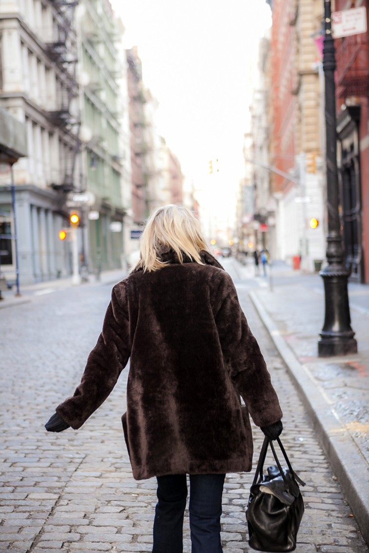 Brown faux fur coat, cobblestone streets of New York