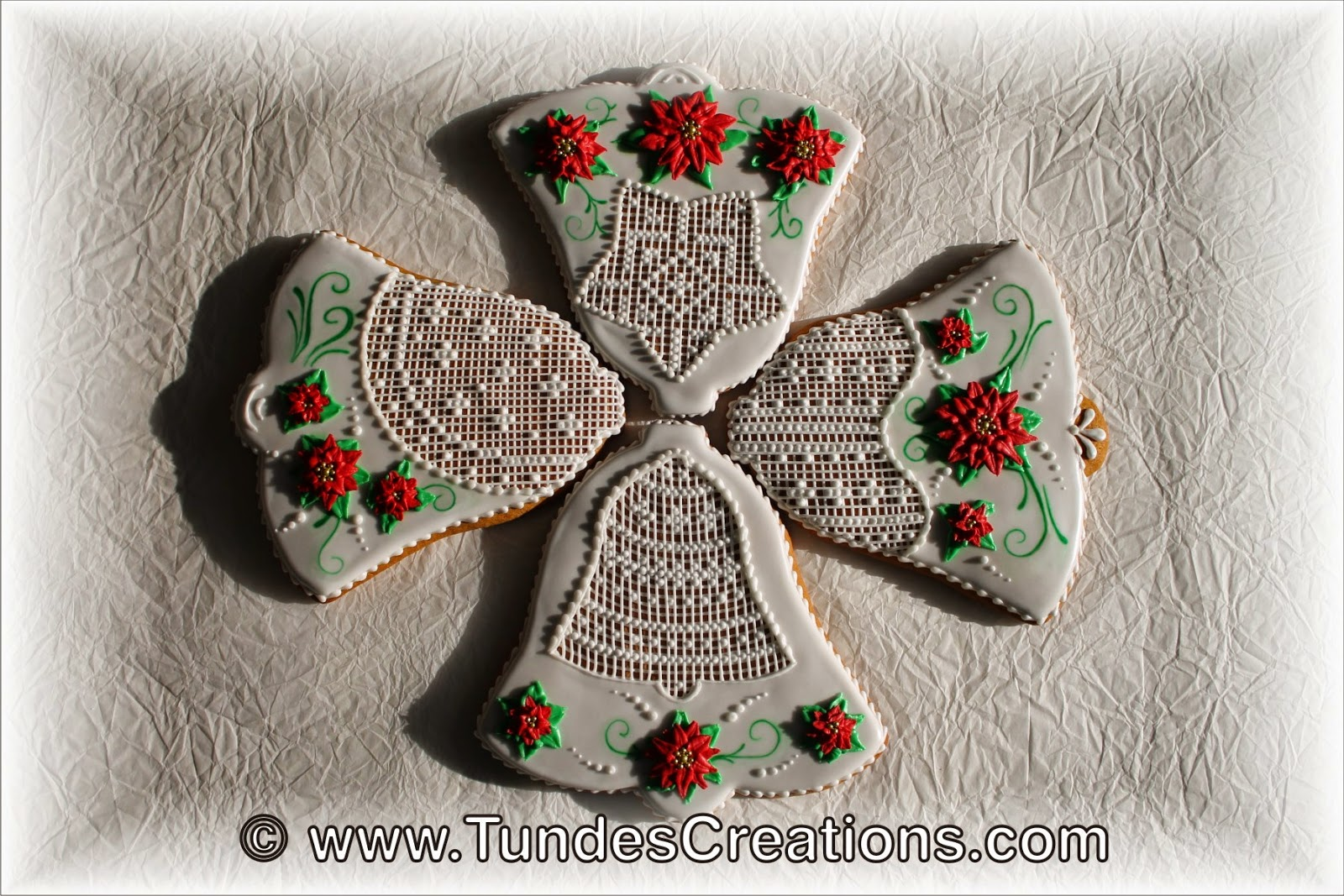 White bell cookies with poinsettias