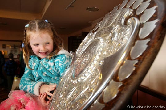 Michaela Balchin, 5, Taradale, with the Ranfurly Shield, at Fan Fiesta, Napier Municipal Theatre, Napier, celebrating today's rugby test at McLean Park, Napier, between Argentina's Los Pumas and the All Blacks photograph