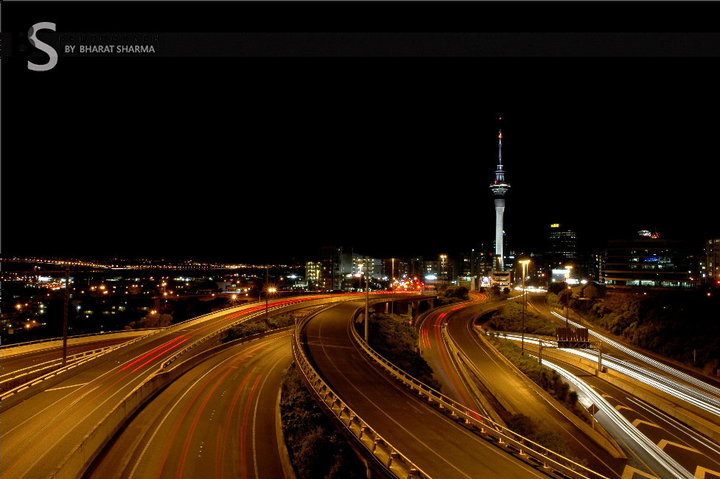 After some of the interesting PHOTO JOURNEYs by Bharat, here is another PHOTO JOURNEY from New Zealand. This time some sparkling Night photographs from Aukland Sky Tower and other places around the same. Let's check out this fourth Photo Journey after Mount Taranaki, Bay of Islands, Helicopter Ride to AorakiMount Cook World Heritage Park ...A wonderful photograph with night trails of vehicles roaming around Aukland Sky Tower of New Zealand. Amazing lighting on Sky Tower make this photograph more beautiful and adds more glow to the light trails of cars moving in all possible directions...The Sky Tower is actually a telecommunications tower located on the corner of Victoria and Federal Streets in the Auckland CBD, Auckland City, New Zealand. It's also an observatory of New Zealand. A Closer look to Sky Towers show some sparkling offices in the middle of it and some of us debating about it's being an office or a sort of party lounge in Sky Tower building... After check Wikipedia, we got to know that it's a revolving restaurant. Imagine yourself sitting in this restaurant and looking at the other places around this tower. At the same time I wish that there is no fog like in Delhi, India... Long time back we visited one of the revolving restaurant in Delhi and it was foggy day. It seems that restaurant gives some amazing views of President's house, Connaught Place, Birla Temple, India Gate and other important places of Delhi.The SKY Tower is Auckland's primary FM radio transmitter and its considered as second major terrestrial television transmitter (after Waiatarua in the Waitakere Ranges to the west). It hosts total of twenty-three FM radio stations, two VHF analogue television channels, and three digital terrestrial television multiplexes broadcast from the tower.The analogue television channels will switch off in the early hours of Sunday 1 December 2013 as part of New Zealand's digital television transition.Check out en.wikipedia.org/wiki/Sky_Tower to know more about Sky Tower in Aukland, New Zealand !!!Height of Sky tower is approximately 330 metres and it's considered as tallest free-standing structure in the Southern Hemisphere. Due to its shape and height, especially when compared to the next tallest structures, it has become an iconic structure in Auckland's skyline.Wonderful view of Half moon hiding behind clouds and Sky Towers of Aukland in the foreground. Moving clouds also shows the long exposure shots of Sky Towers of New ZealandDifferent other attractions of Sky Tower can be explored on following website - http://www.skycityauckland.co.nz/Attractions/Skytower.htmlApart from restaurants, it also talks about activities like Sky jump and Sky Walk. Not sure if these activities are always provided or there are some special occasions for the same. It must be a wonderful experience to have Sky jump from Sky Tower and at the same time, it would be an extremely courageous thing to do..Thanks Bharat for sharing wonderful Photo Journey of Night Life around Sky Towers in Aukland, New Zealand. More details about entry fees can be checked at http://www.skycityauckland.co.nz/Attractions/Skytower/Admissions.html