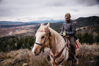 riding horseback into the teton wilderness in wyoming.