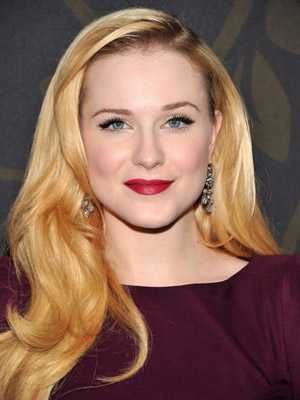 Evan Rachel Wood takes the retro route with a deep side part and brushed-through glamour waves.