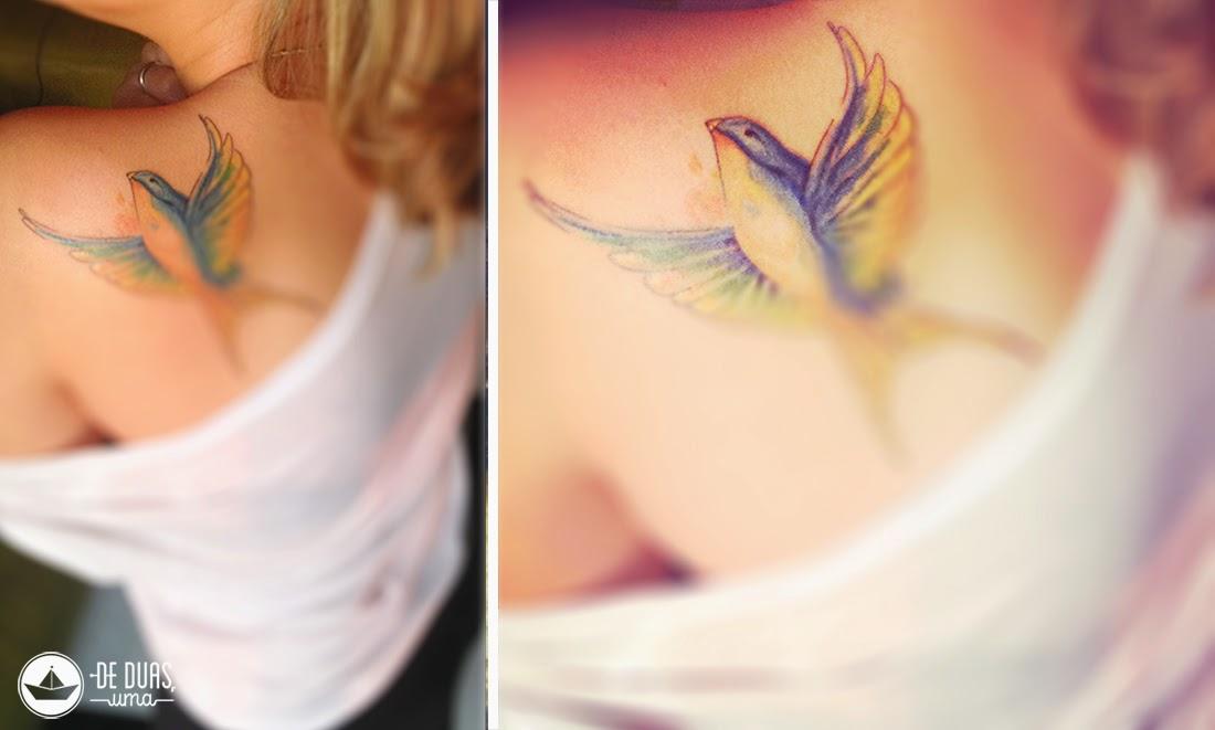 tatuagem andorinha nas costas aquarela