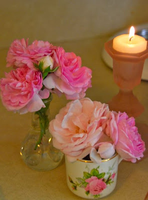 Rose bouquets from the garden in tiny tea cups and vases. Candles are always nice!